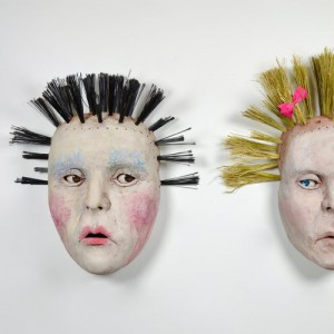 "Detail of ""The Barbaras"" by Teresa Larrabee, 5 stoneware, acrylic, broom bristles, crayon, bows"