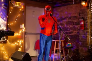 Seth Mallloy recites poetry dressed as Spider-Man. Photo: Leah Jones.