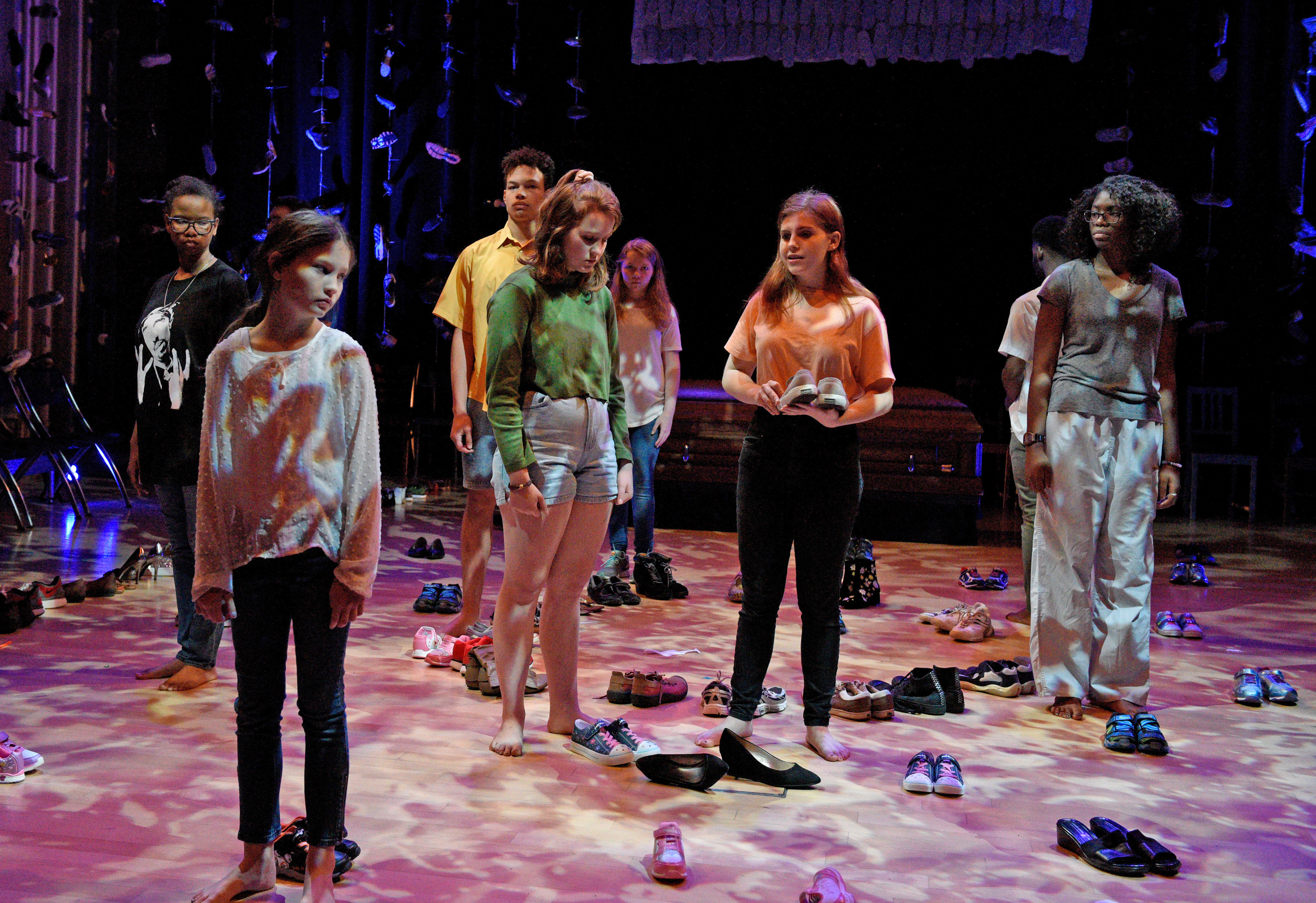 "The cast of ""Babel"" place shoes on stage as representations of people who've been killed by guns. Photo: Karen Almond"