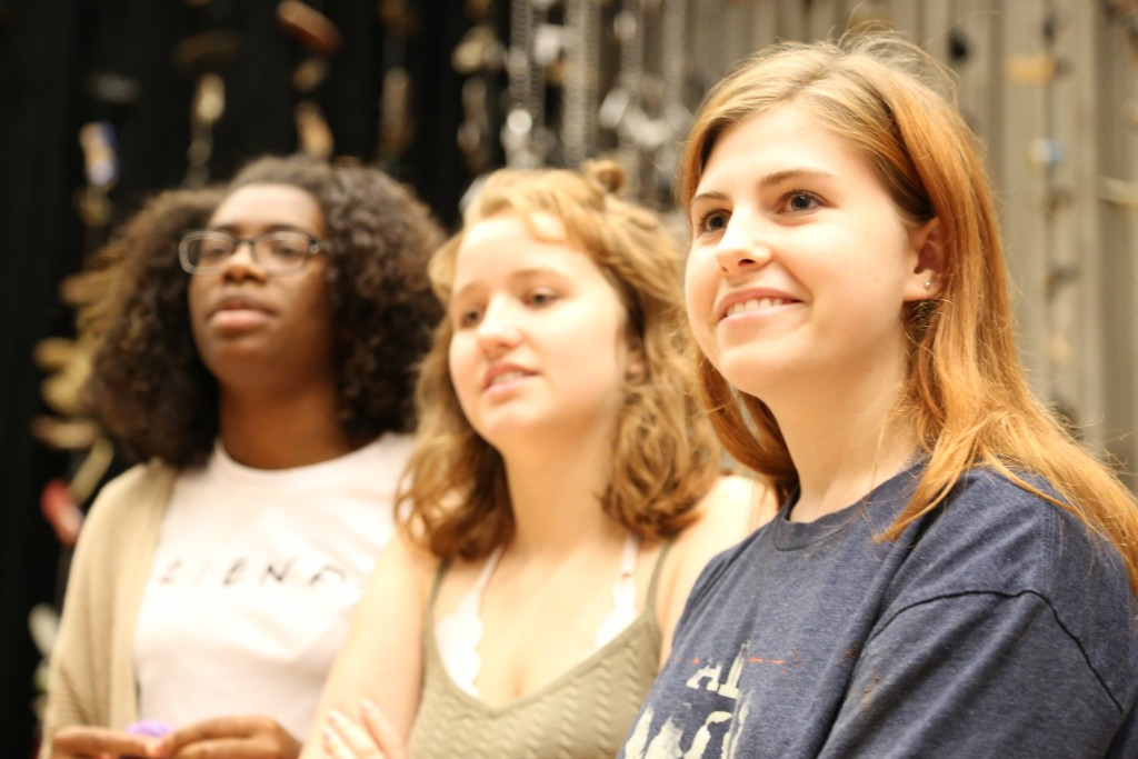 Cara Lawson, Angie Hoag and Trinity Gordon listen for instruction during rehearsal. Photo: Hady Mawajdeh
