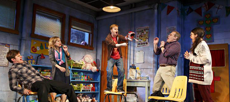 Michael_Oberholtzer__Geneva_Carr__Steven_Boyer__Marc_Kudisch_and_Sarah_Stiles_in_a_scene_from_HAND_TO_GOD_on_Broadway_-_Photo_by_Joan_Marcus_0