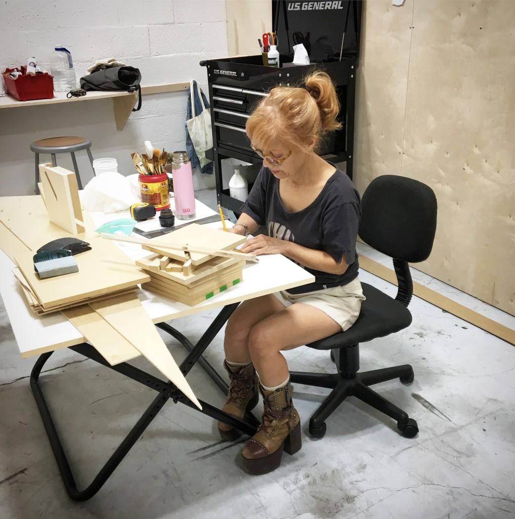 working at table Fari Rahimi