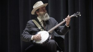 Wayne White play banjo during his lecture at UNT. Visuals: Sarah Reyes and Daniel Driensky, Exploredinary