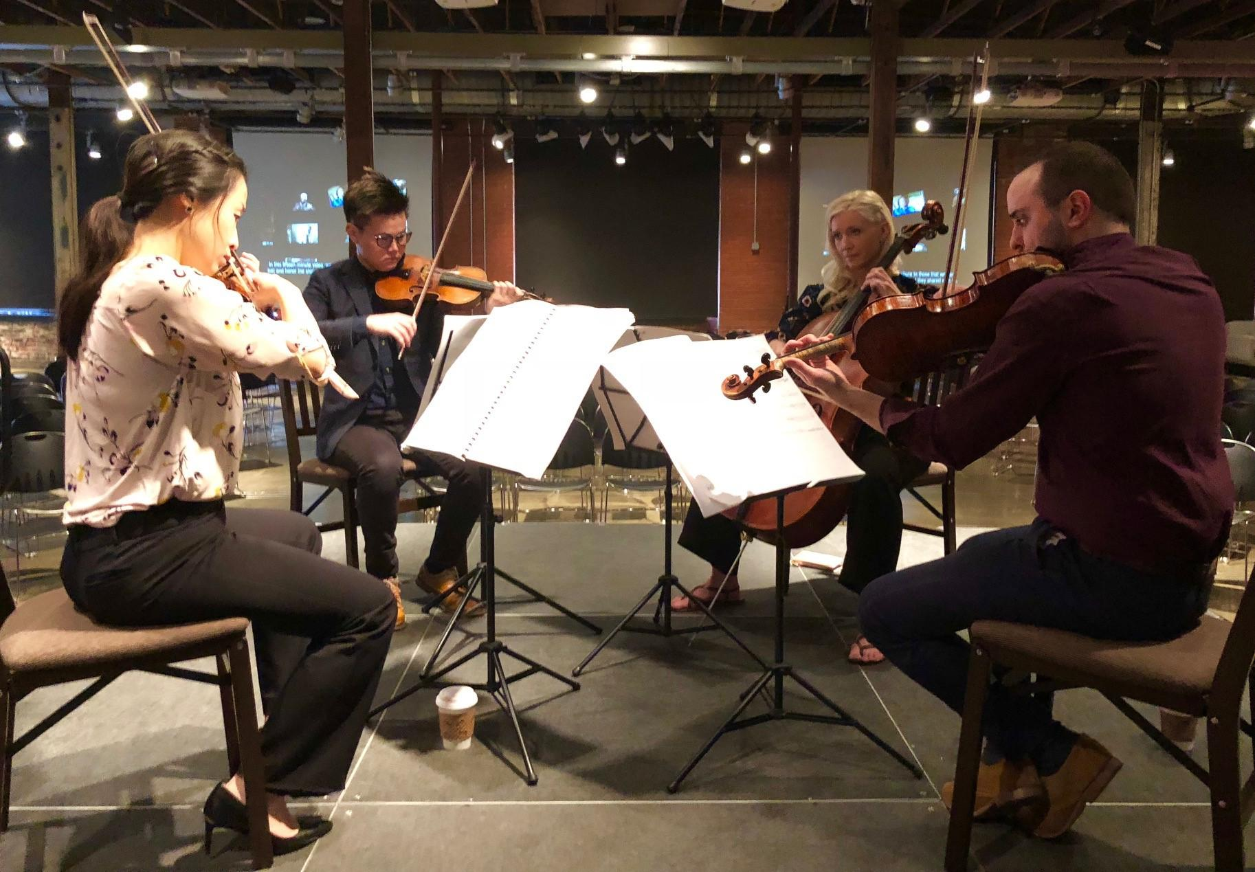 """The Julius Quartet, the Peak Fellowship Ensemble-in-Residence at SMU's Meadows School of the Arts, performed the composition, """"The Sixth Floor,"""" on Presidents Day at The Sixth Floor Museum at Dealey Plaza. From left: violinists Hyun Jeong Helen Lee and David Do, cellist Brooke Scholl and violist John Batchelder. Photo: Stella M. Chávez / KERA News"""