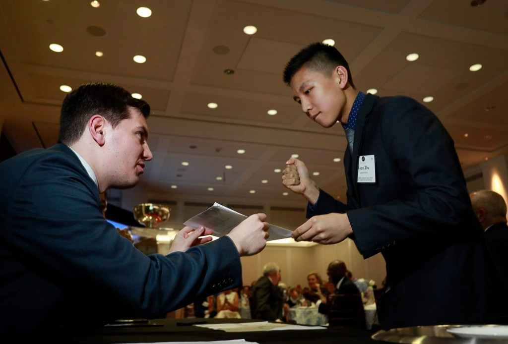 Ryan Zhu of Canada picks the first performance slot in the draw party for the Cliburn International Junior Piano Competition held at the Bush Institute in Dallas, Texas. Photo: Ralph Lauer courtesy The Cliburn