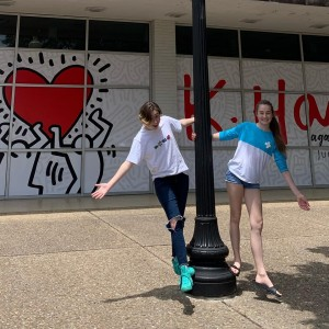Cameron DeLay (left) and her sister Ashley posing in front of the Arlington Museum of Art. Photo: Stephanie Delay