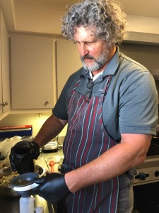 Fort Worth artist Marshall Harris cooks for firefighters at Station 23. Photo: Hady Mawajdeh