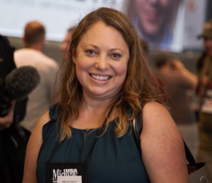 Cry Havoc's founder and artistic director Mara Richards Bim at the NRA's annual meeting. She's in line to attend the event's biggest happening - the NRA's leadership forum. Photo: Hady Mawajdeh/KERA News