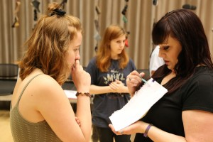 Actress Angie Hogue and technical director Sarah Duc review stage notes during rehearsals for 'Babel.' Photo: Hady Mawajdeh/KERA News