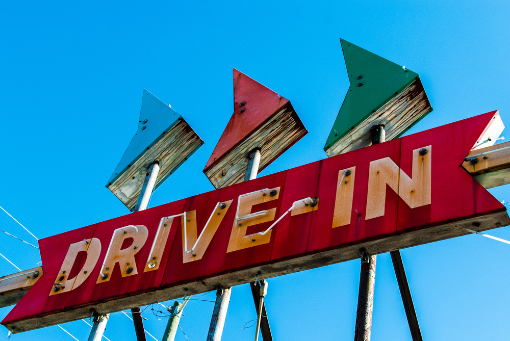 """Red antique light up sign that says """"Drive-In"""