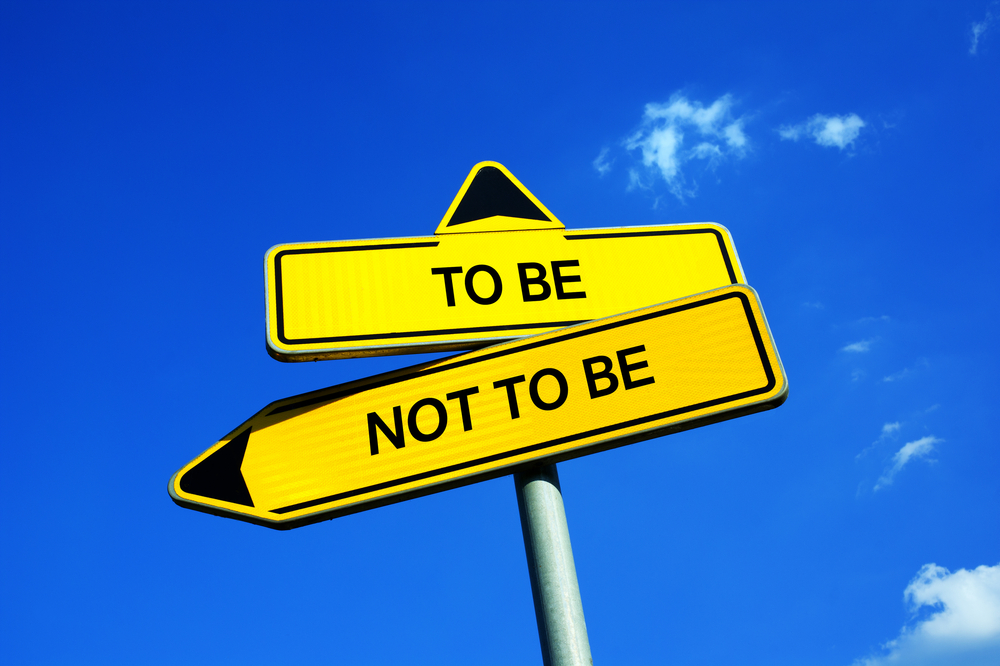 "crossed street signs that read ""to be"" and ""not to be"""