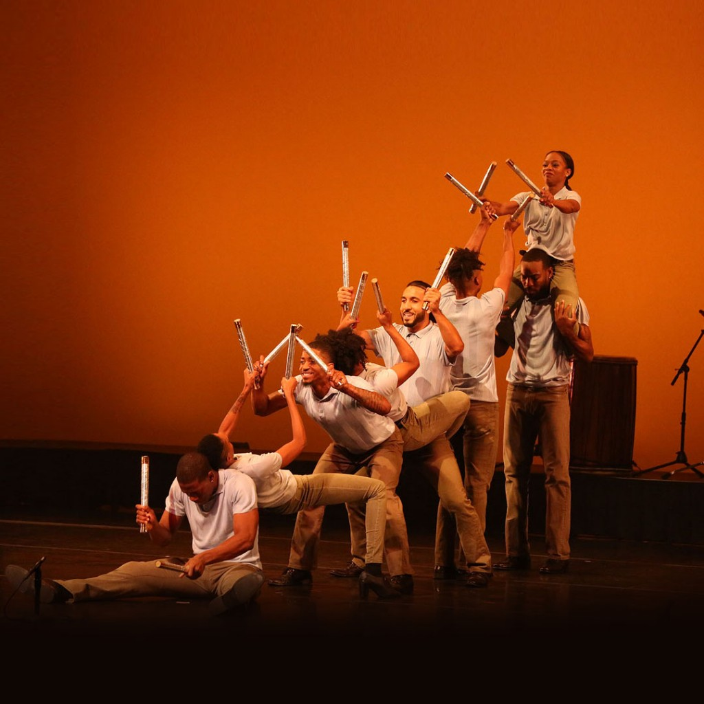 DanceAfrika! dancers performing with sticks