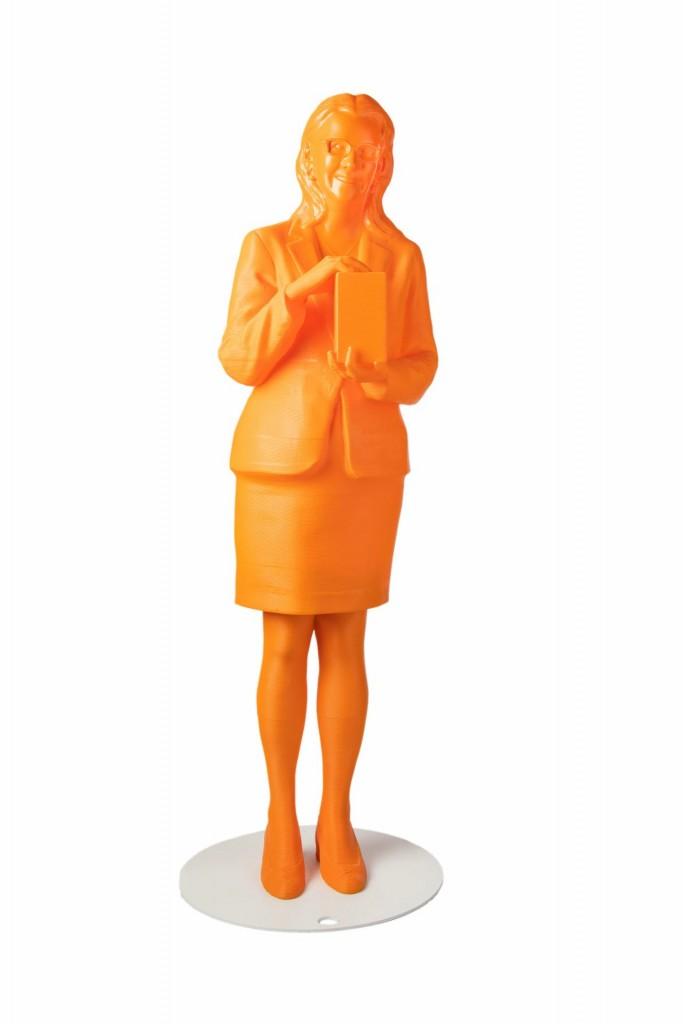 Minerva Cordero displayed in a orange 3D printed statue