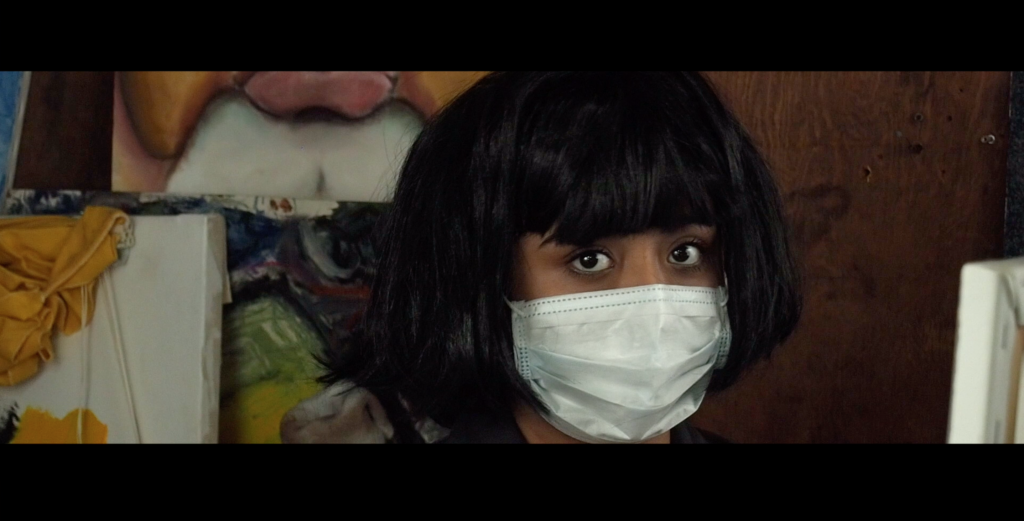 "A character in ""The Savage Seconds"" stares at the camera with a disposable mask on."