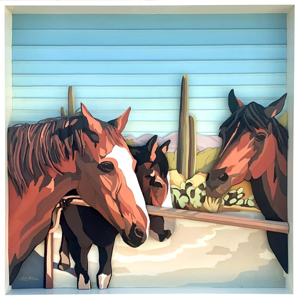 Acrylic painting on corrugated board by Landry McMeans. It shows three brown horses in a corral. In the background are tall cactuses.