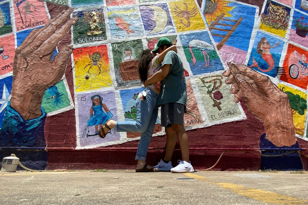 Sofia Popescu and Jason Bobadilla in front of an Austin loteria mural in May 2020