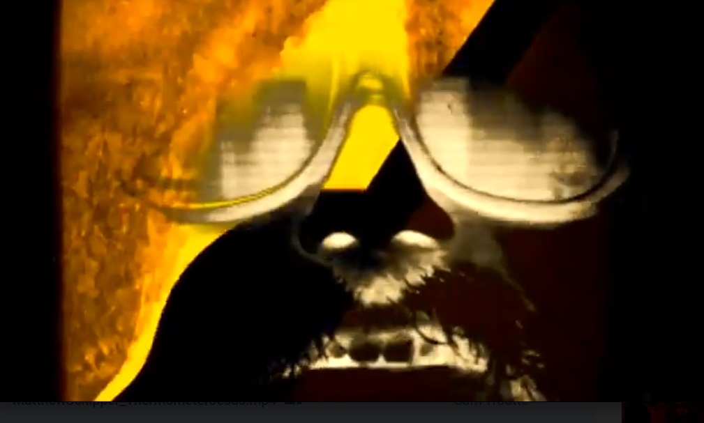 Psychedelic image of man wearing glasses and singing.