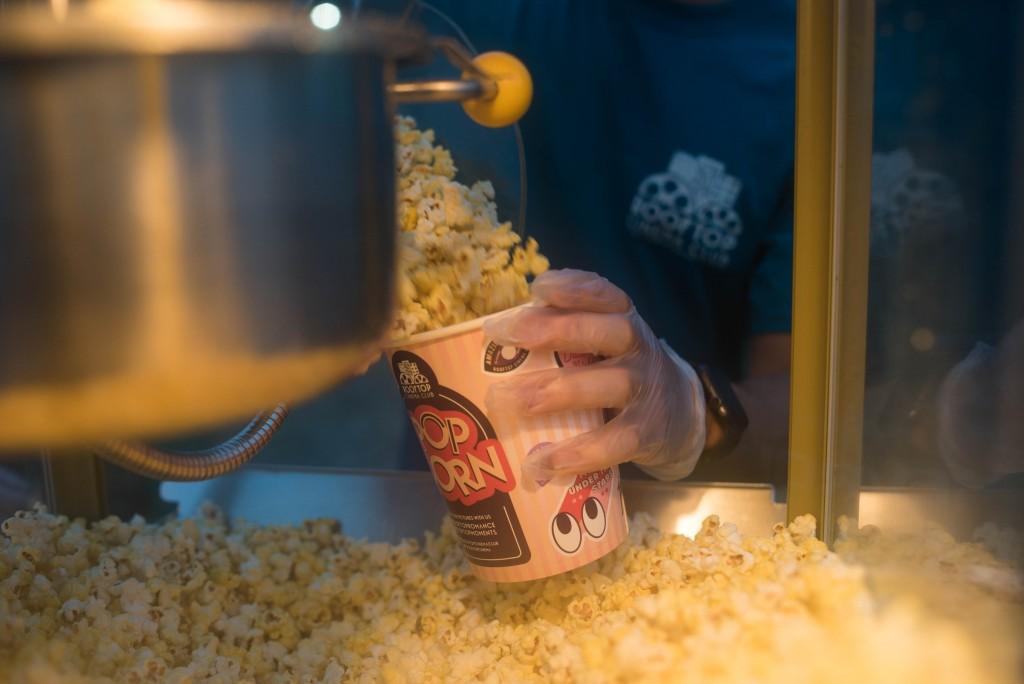 someone serving hot popcorn