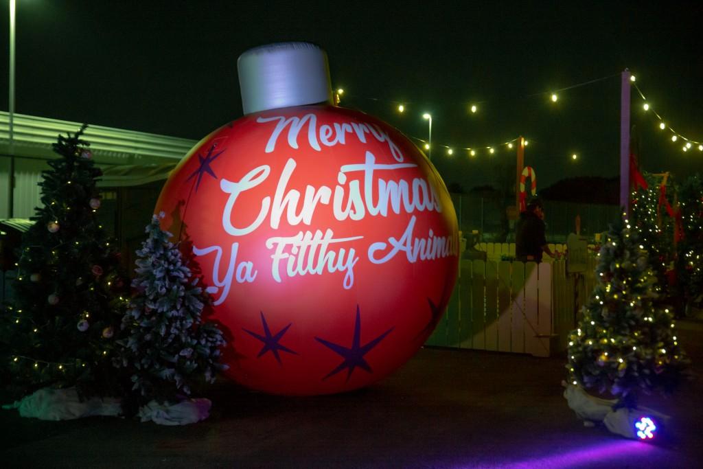 """big Christmas ornament with the saying """"Merry Christmas, ya filthy animal."""""""