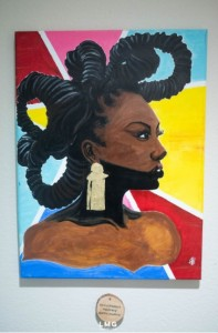 Portrait of African woman by Art-Fro Kreationz. She has multiple coiled braids twisted on her head.