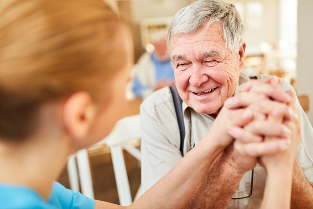 Older man laughing with woman