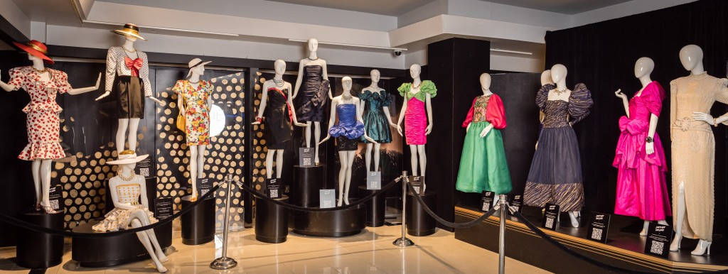 display of dresses from the '80s on plastic white mannequins.