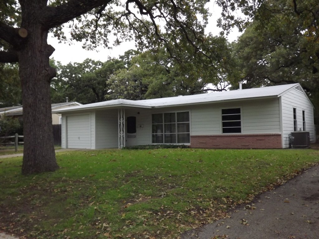 Small, white, mid-century home.