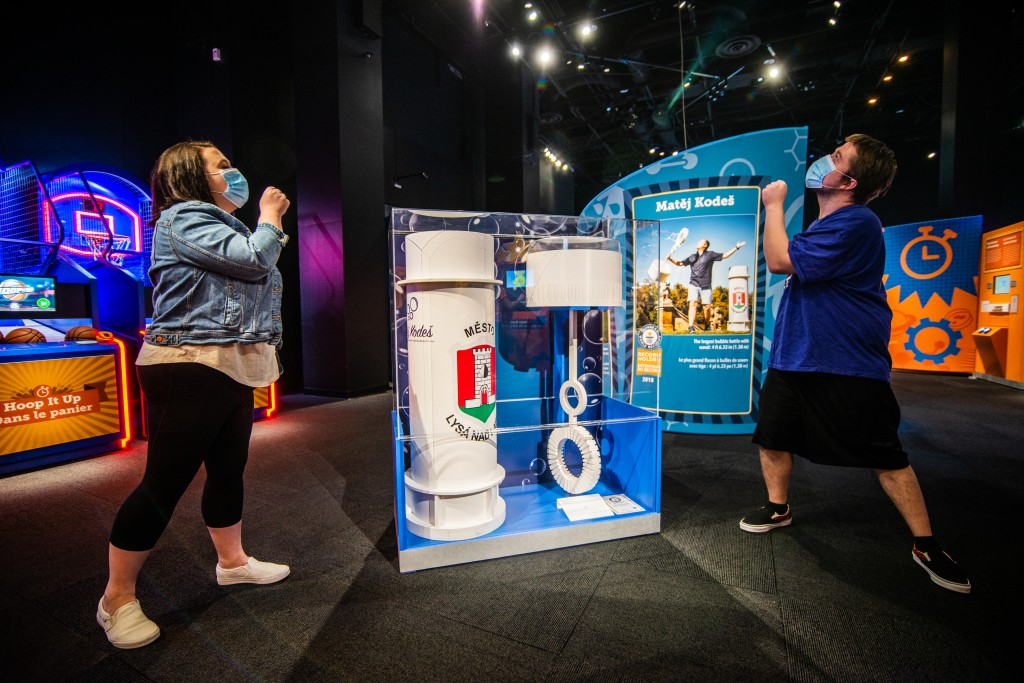 woman and man playing a game at the Perot Museum.