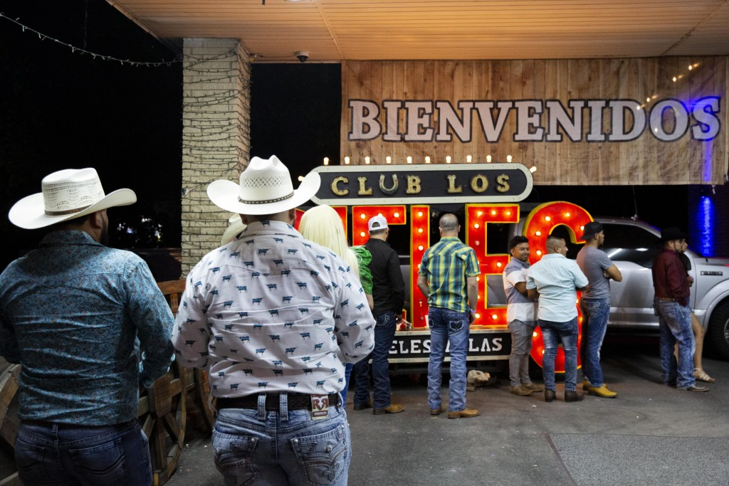 Patrons wait in line to enter Dallas' Club Los Rieles in mid-June. (Juan Figueroa/The Dallas Morning News)